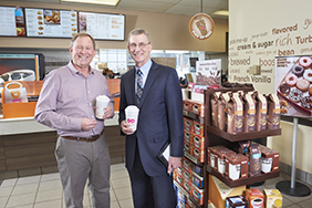 Chris Swanson, Ashland Dunkin' Donuts franchise owner with John Swedberg, SVP, Commercial Loan Officer, Meredith Village Savings Bank.